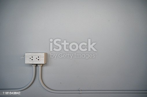 940992564 istock photo electric switch with  surface background. 1181543842