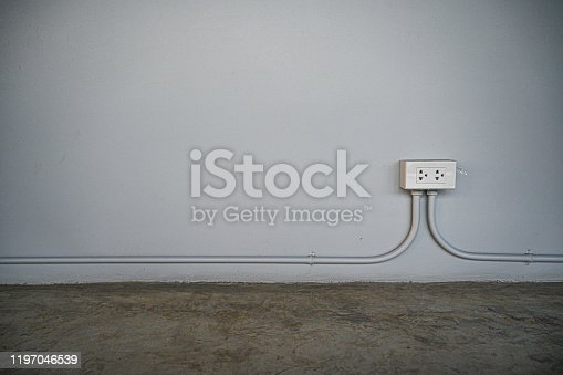 940992564 istock photo electric switch with  surface background. 1197046539