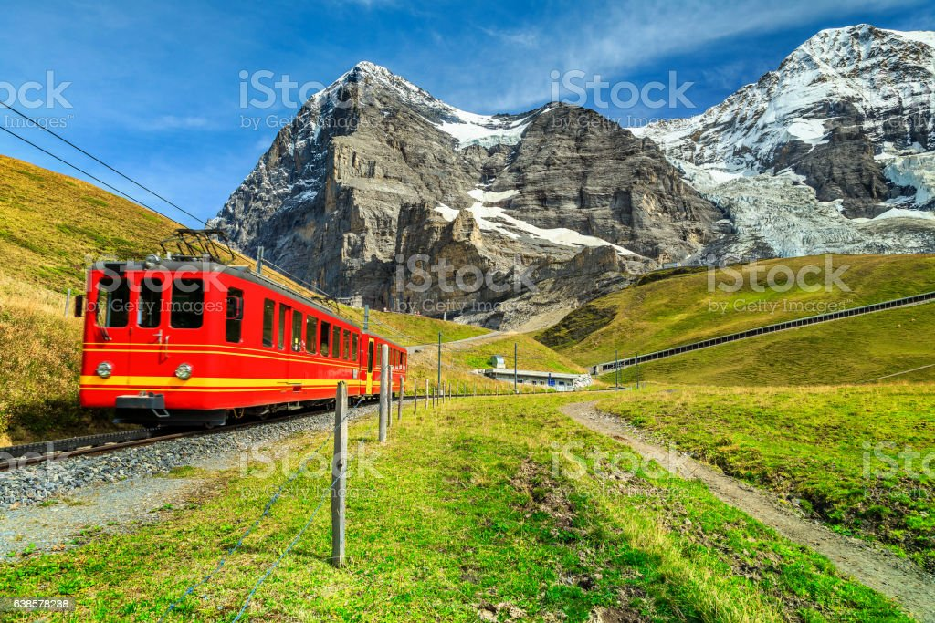Electric tourist train and Eiger North face, Bernese Oberland, Switzerland stock photo