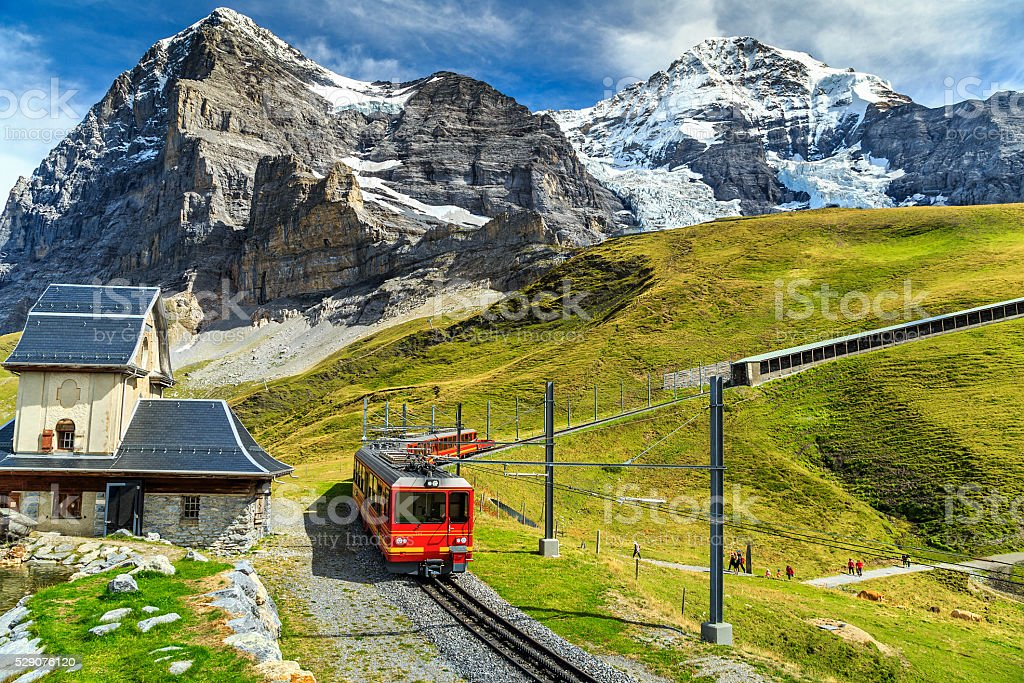 Electric tourist train and Eiger North face,Bernese Oberland,Switzerland stock photo