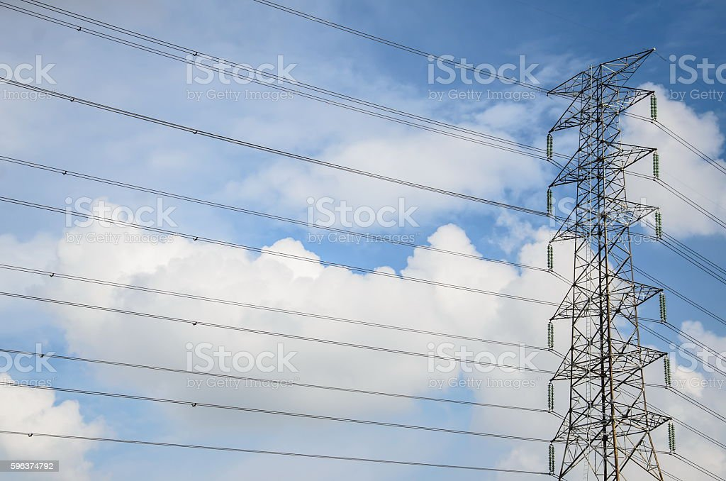 Electric tower ultra wide angle over blue sky with clouds stock photo