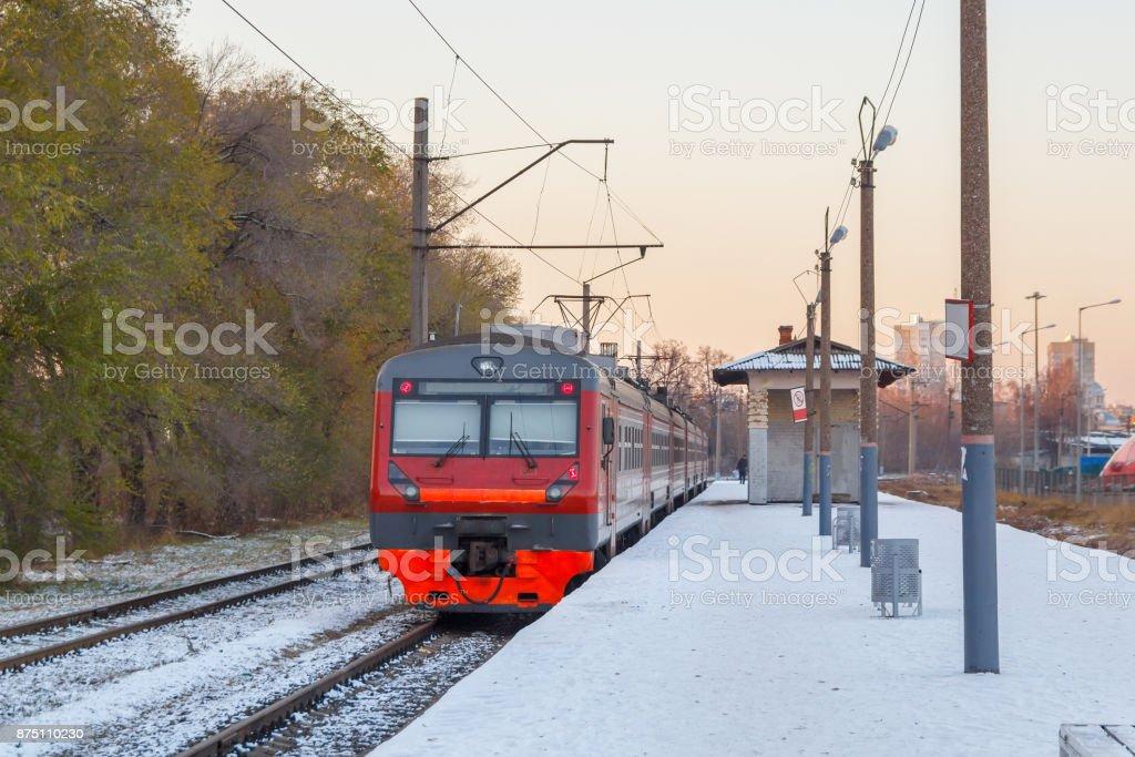 Electric train awaits passengers on the platform stock photo