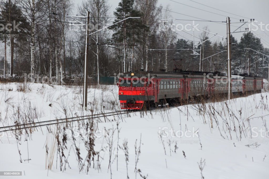 electric train on snow-covered winter railway stock photo