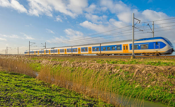 Electric train riding through nature in winter Electric train riding through nature in winter electric train stock pictures, royalty-free photos & images