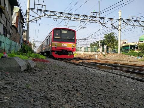 Stasiun Duri, Jakarta, Indonesia - June 10, 2020 : Electric trains that cross the railroad tracks
