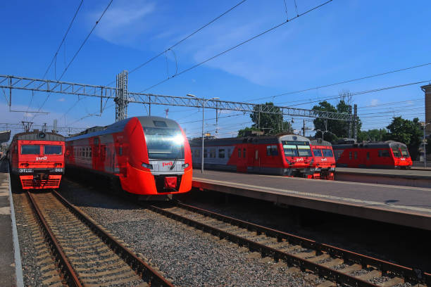 electric trains waiting for passengers on the platform June 18, 2020, Russia, St. Petersburg, suburban electric trains at the station platforms electric train stock pictures, royalty-free photos & images