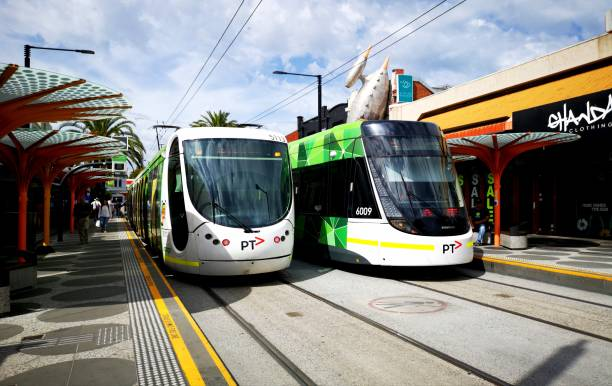 Electric Tram - Melbourne Melbourne, Australia: March 05, 2019: Two electric trams have reached their final destination in Acland Street, St Kilda before returning to the city. Yarra Trams run the service throughout the Melbourne suburbs. electric train stock pictures, royalty-free photos & images