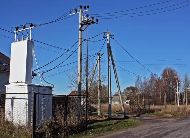 electric transformer and power line in the village in the remote area - village stock photos and pictures