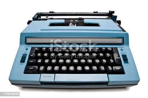 Antique blue electric typewriter isolated on white