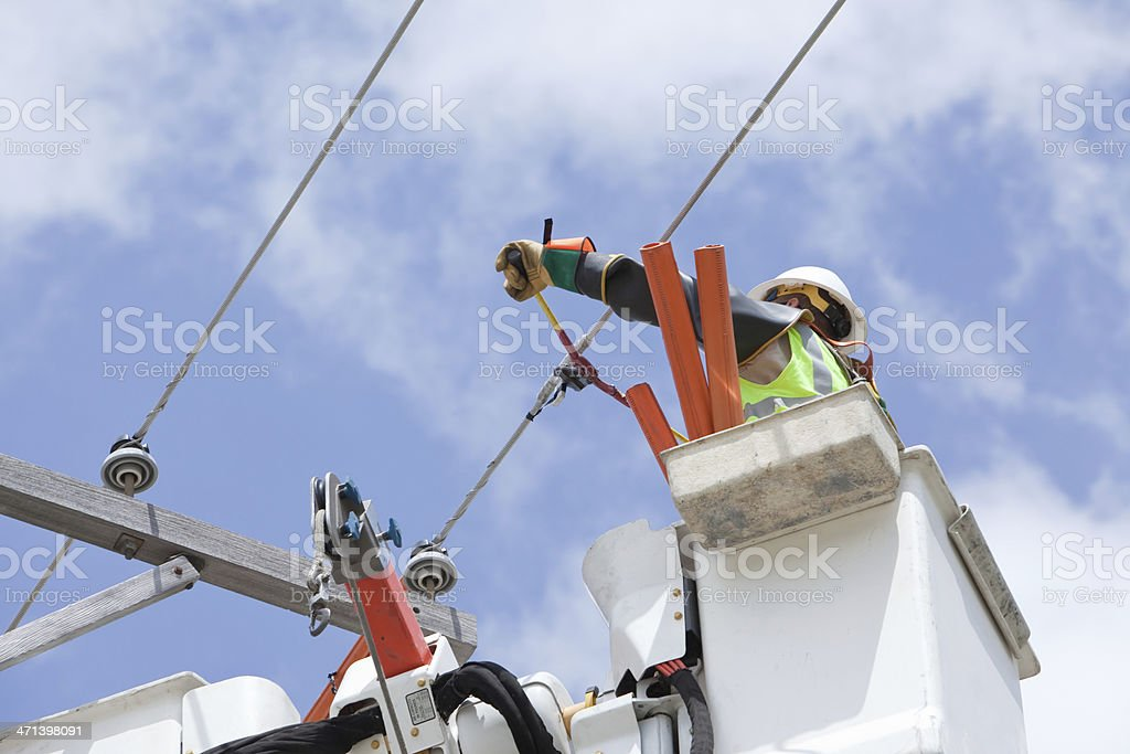 Electric Utility Lineman Cuts Jumper Wire Connection stock photo