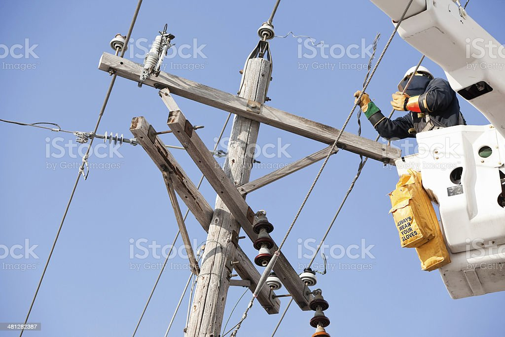 Electric Utility Lineman Repairing Damaged Pole stock photo