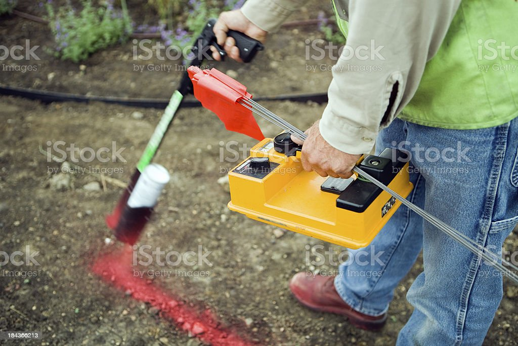 Electric Utility Locator Using Radio Frequency Detector to Mark Line royalty-free stock photo