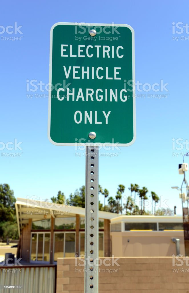 Electric Vehicle charging sign, a power source eventually expected to replace fossil fuels such as gasoline and oil in operating a car and other motor vehicles stock photo
