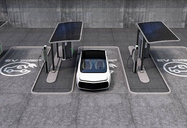 Electric vehicle charging station in public space stock photo