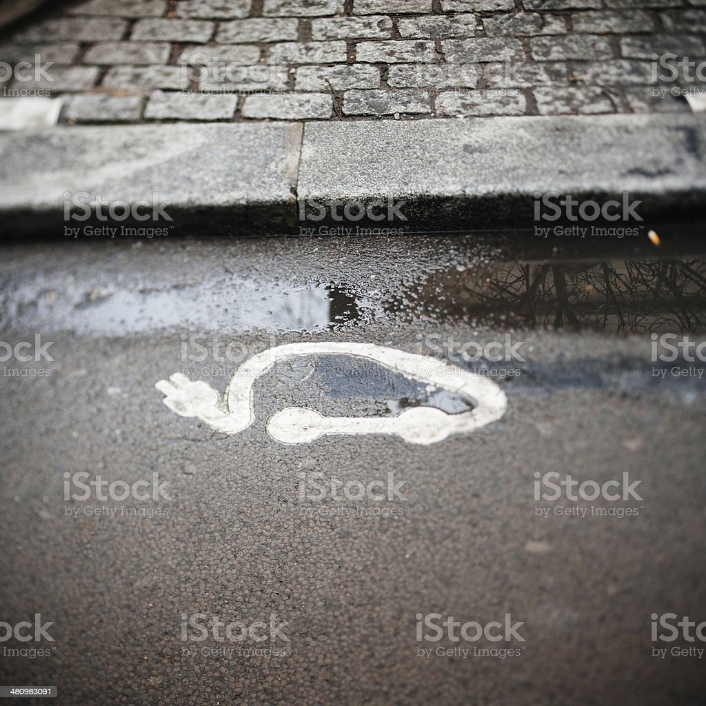 Electric vehicle charging station sign stock photo