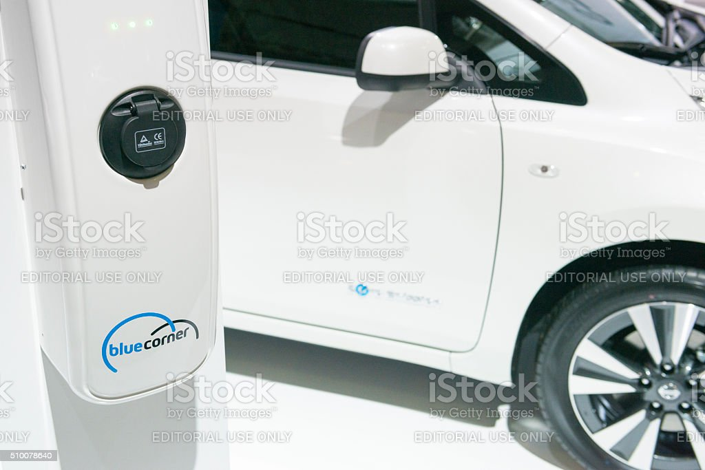 Electric Vehicle Charging Station With Nissan Leaf Full Electric Car  Royalty Free Stock Photo