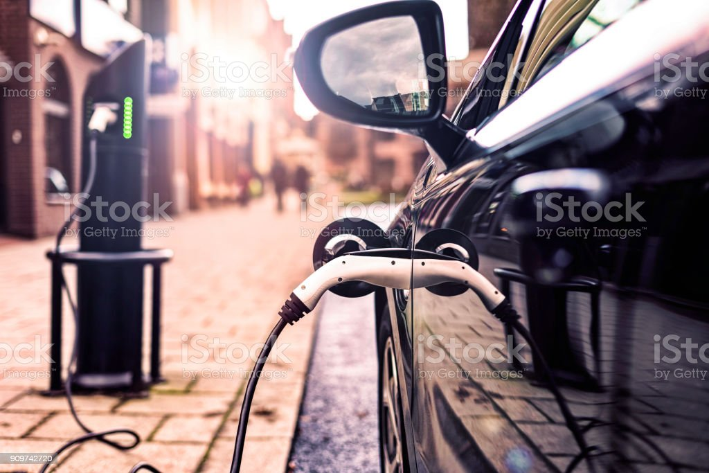 Electric Vehicle in Park Street Charging station Electric Vehicle in Park Charging station in UK Street Alternative Fuel Vehicle Stock Photo