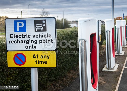 an electric vehicle charging station showing sign and several charging points