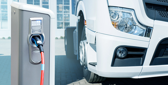 Electric vehicles charging station on a background of a truck. Concept