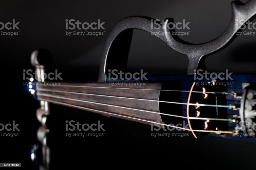 Electric violin. Modern orchestra musical instrument used in contemporary popular classical music stock photo