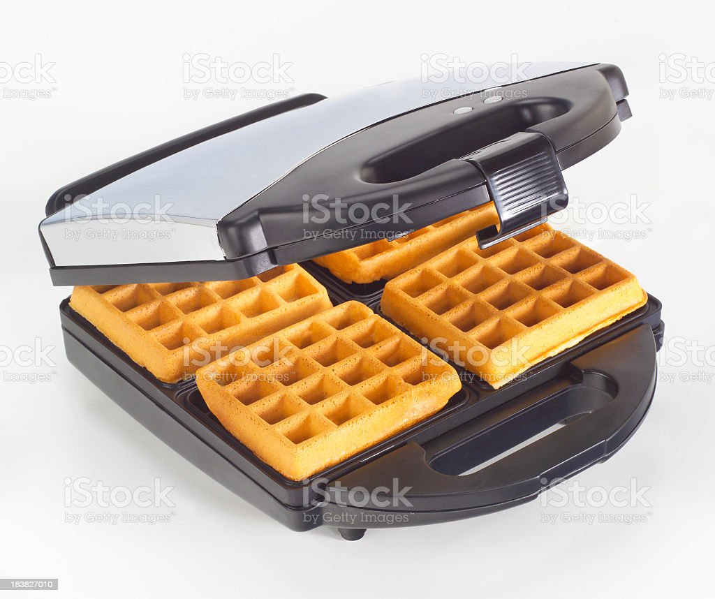 Electric waffle maker with hot waffles stock photo