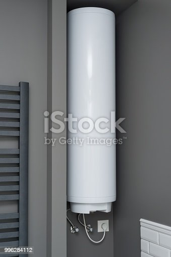 istock Electric water heater boiler in the bathroom interior. Interior details close-up. 996284112