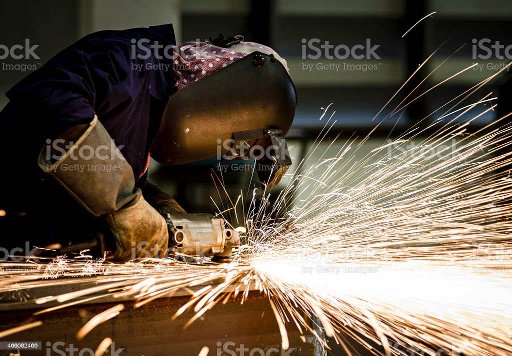 Electric wheel grinding on steel structure stock photo