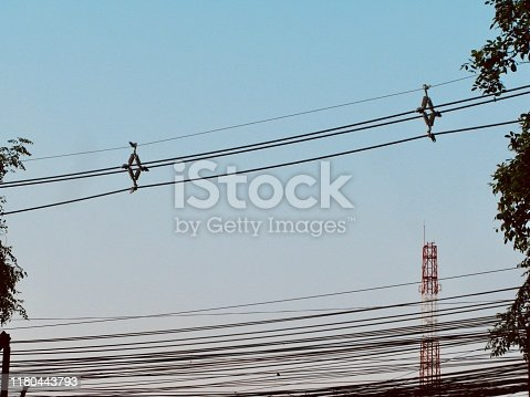 Chaos of Wires, Telephone Line on The Pole Against Blue Sky.