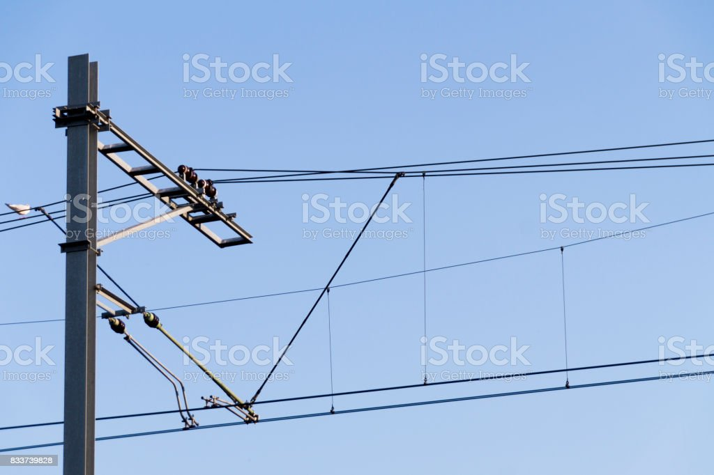 electric wiring for railway against blue sky stock photo