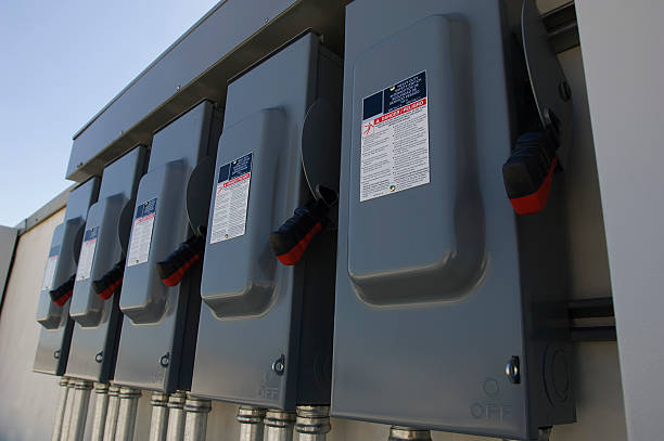 electrical breaker boxes at solar power plant - fuse box stock photos and pictures