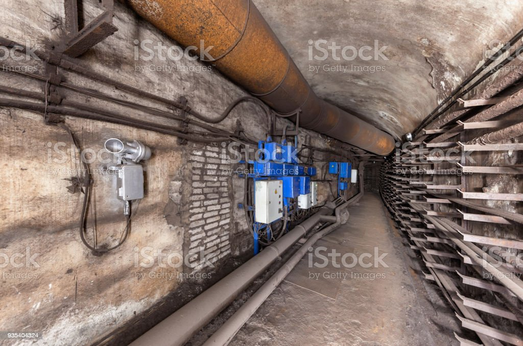 Electrical cabinets and other equipment in underground communication tunnel stock photo
