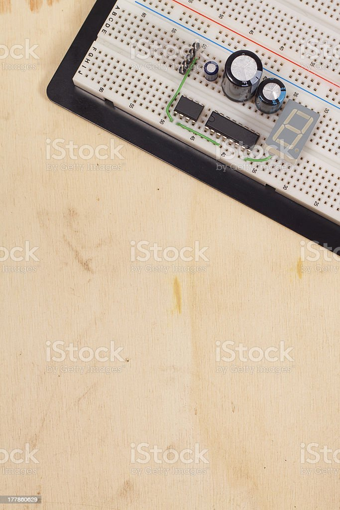 Electrical circuit in breadboard on dirty wooden background royalty-free stock photo