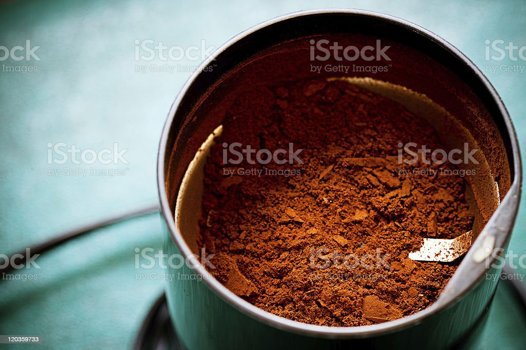 Electrical coffee-mill machine with milled ground coffee stock photo