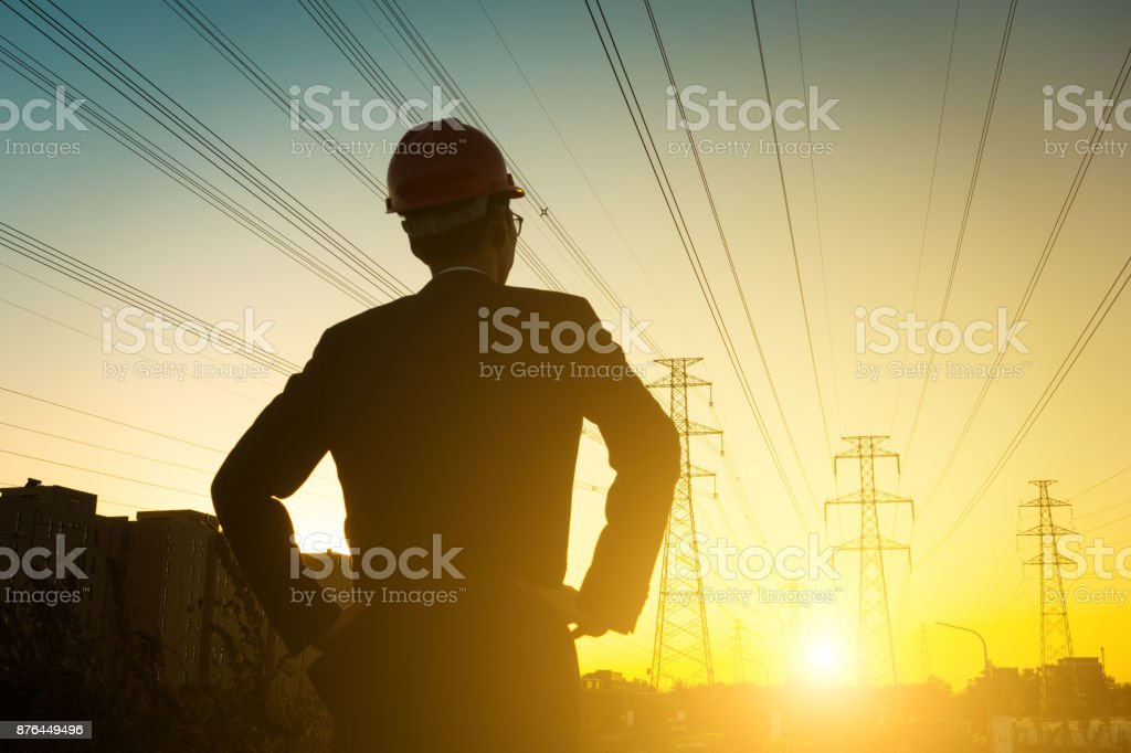 Electrical engineer at sunset,Back Lit stock photo