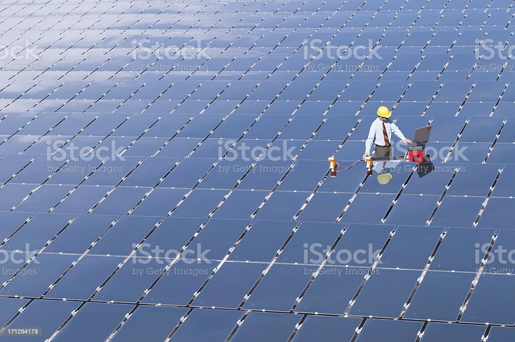 Electrical engineer in solar panel field royalty-free stock photo