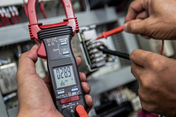 Electrical Engineer is check electrical equipment with a multi-meter Electrical Engineer is check electrical equipment with a multi-meter meter instrument of measurement stock pictures, royalty-free photos & images