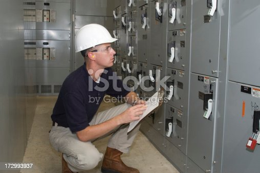 Factory Engineer or Inspector checking electrical circuits.
