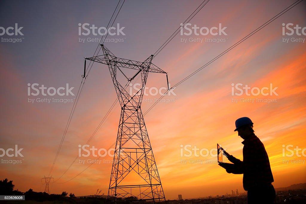 Electrical engineer while working laptopl bildbanksfoto