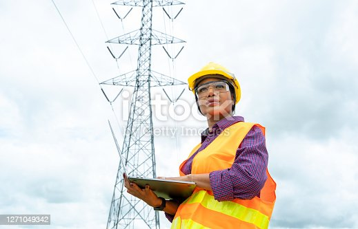 Electrical engineer women use laptop working and checking the power grids.