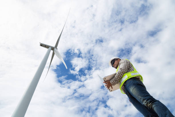Electrical engineer working at wind turbine power generator station stock photo