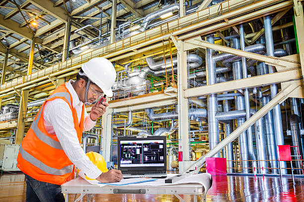 Electrical engineer working in modern thermal power plant Electrical engineer working in modern thermal power plant nuclear power station stock pictures, royalty-free photos & images