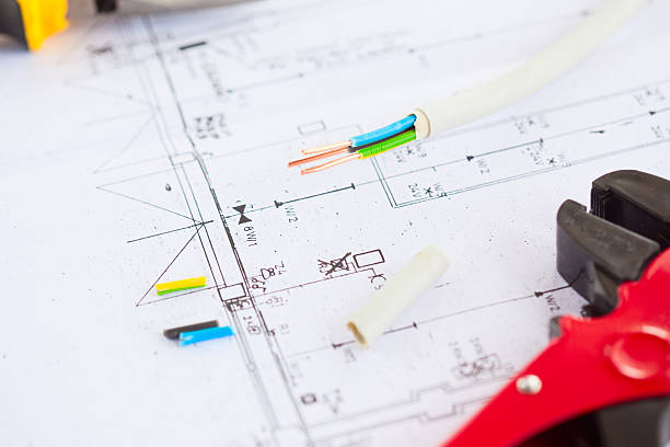Electrical equipment and house plans stock photo