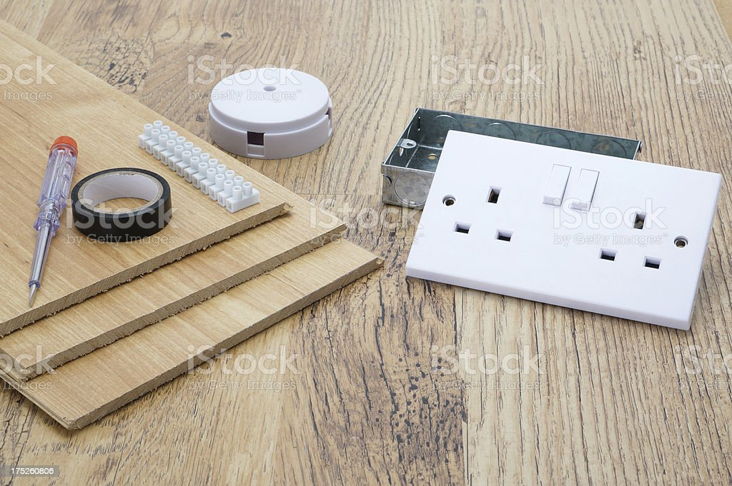 Electrical items and laminate flooring royalty-free stock photo