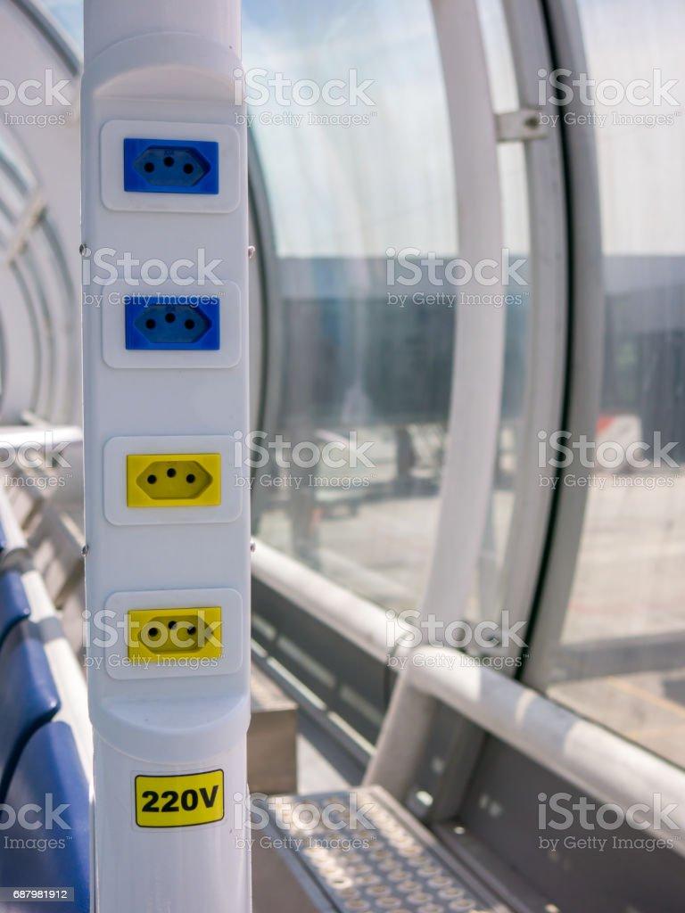 RIO DE JANEIRO, BRAZIL - MARCH 03, 2016 - Electrical outlet in brazilian airport - 110V 220V - santos dumont airport stock photo