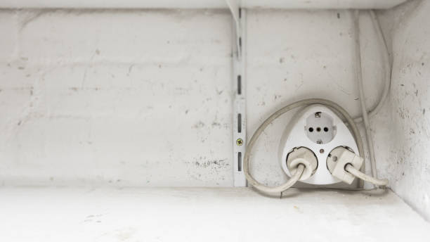 electrical outlet, multi plug, in an old house, 2 pin, europe, - schuko stock-fotos und bilder