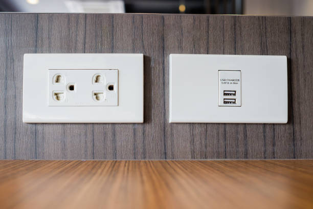 electrical outlet with built in usb charger - electrical outlet stock photos and pictures
