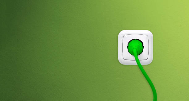Electrical outlet with plug on green wall Electrical outlet with plug on green wall electric plug stock pictures, royalty-free photos & images