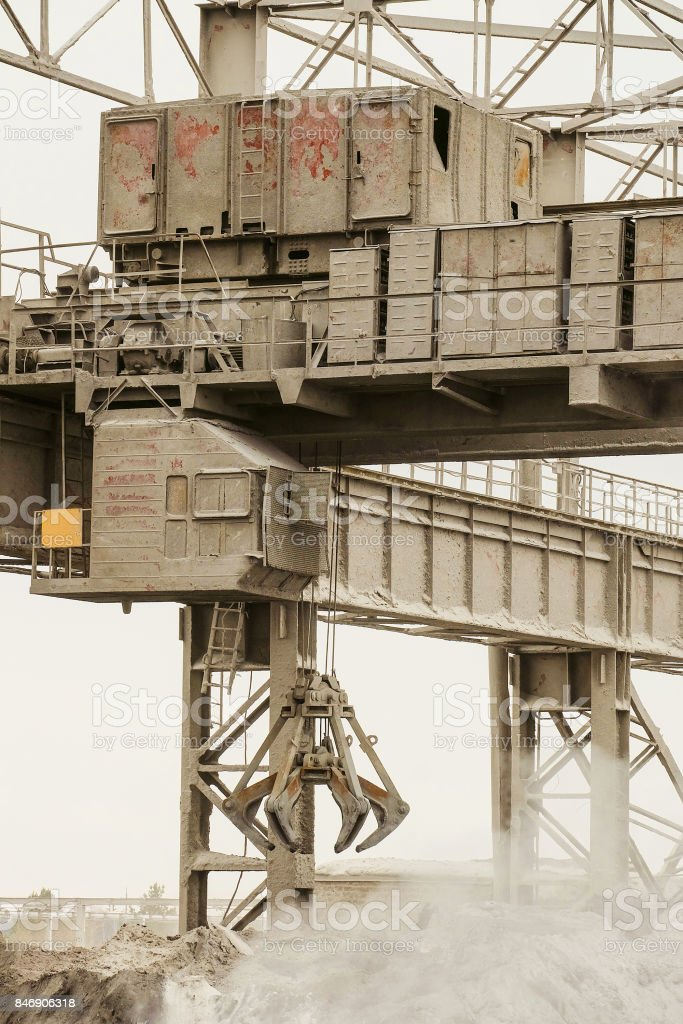 Electrical overhead crane with mechanical multivalve clamshell grab. Heavy industry. stock photo