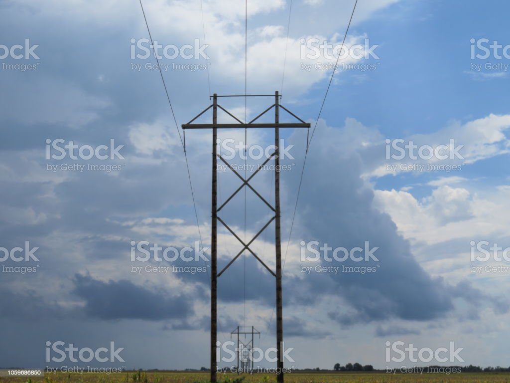 Electrical Poles Stretching Into The Distance Stock Photo - Download
