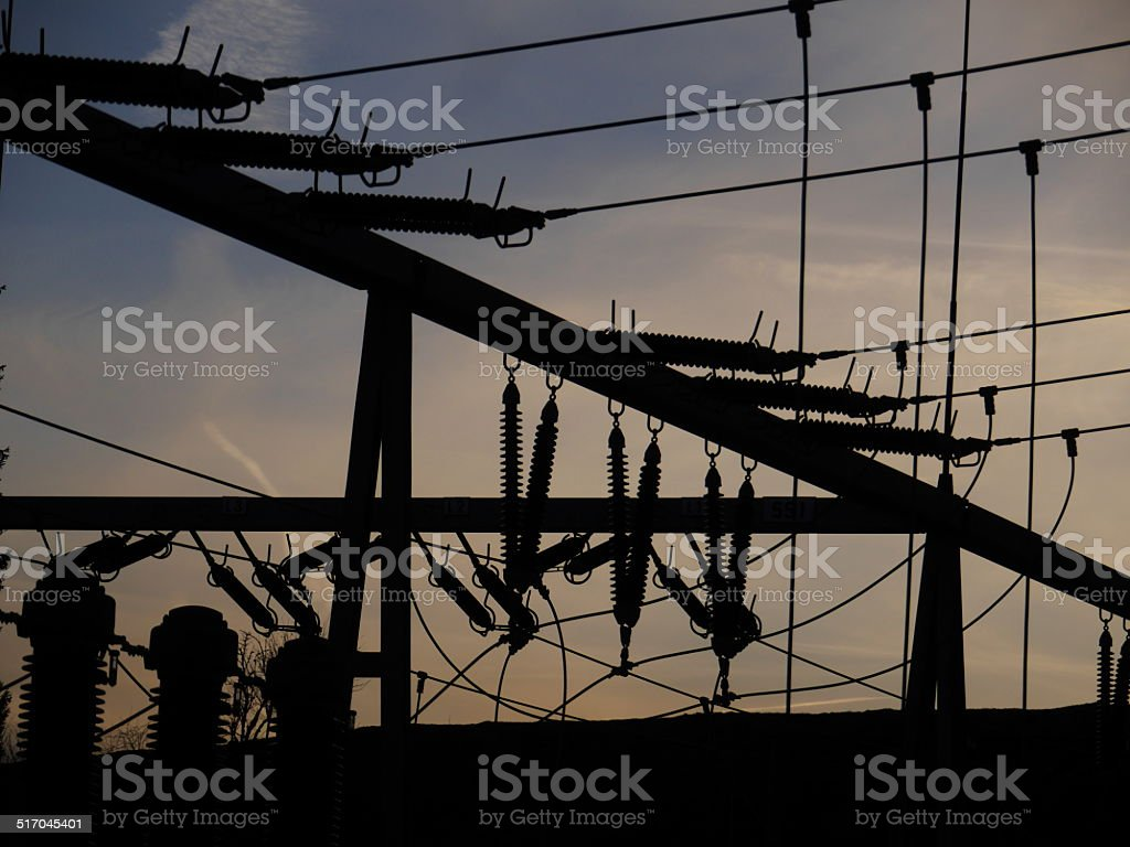 Electrical power grid in silhouette stock photo
